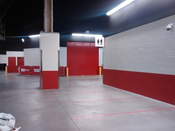 On the other side of the red rollup door is space for a 2nd home team locker room *cough* Raiders *cough*