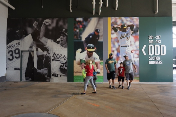 Fans walking in front of the clubhouse mural